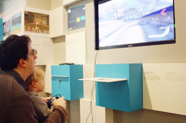 Computer Games Museum Berlin - Father and Son Playing